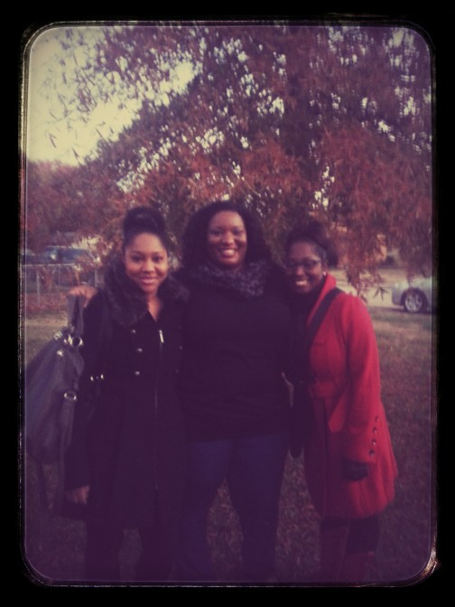 My sister, me and my cousin all trying not to look like we are stuffed full of turkey and what not.